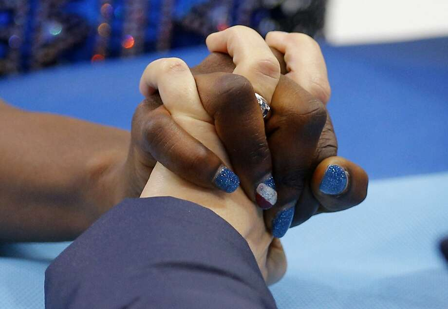 Mae Berenice Meite of France, left, holds hands with her coach Katia Krier as they speak before she competes in the women's free skate figure skating finals at the Iceberg Skating Palace during the 2014 Winter Olympics, Thursday, Feb. 20, 2014, in Sochi, Russia. Photo: Vadim Ghirda, Associated Press