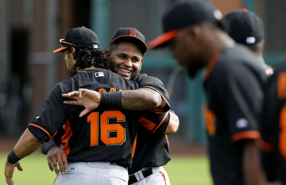 Pablo Sandoval, (48) greets Angel Pagan, (16) at the beginning of practice in Scottsdale, Arizona on Wednesday Feb. 19, 2014. The San Francisco Giants continue their spring training schedule in the Arizona desert with the full squad taking in practice at Scottsdale Stadium. Photo: The Chronicle