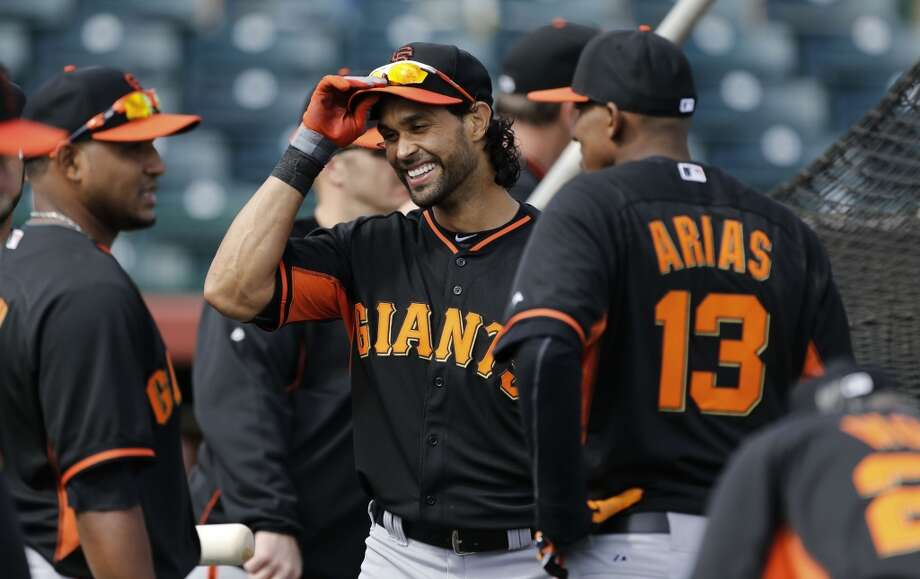 Giants' oufielder Angel Pagan, (16) shares a laugh as he takes a break from batting practice in Scottsdale, Arizona on Wednesday Feb. 19, 2014. The San Francisco Giants continue their spring training schedule in the Arizona desert with the full squad taking in practice at Scottsdale Stadium. Photo: The Chronicle