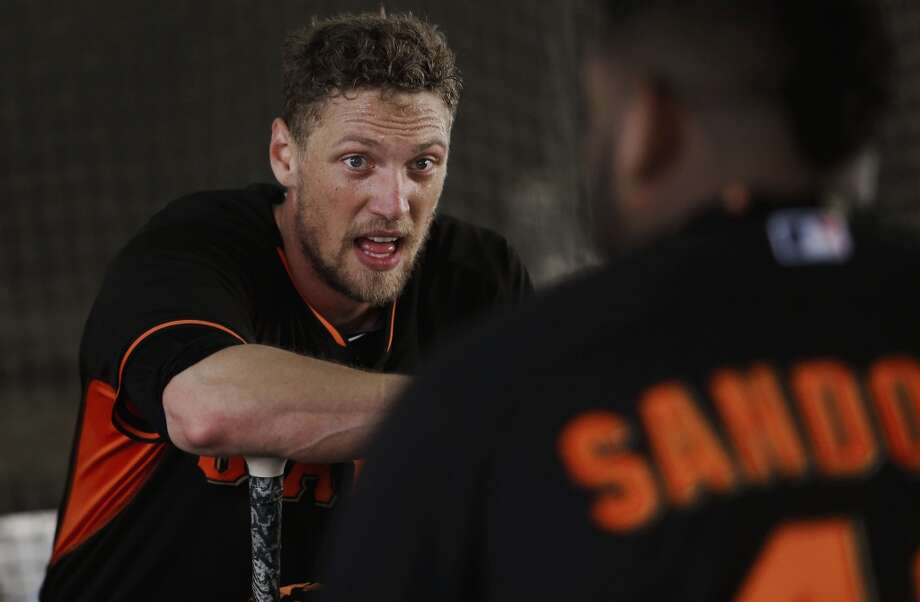 Hunter Pence, (8) takes a break from batting practice to talk with teammate Pablo Sandoval, (48) during practice in Scottsdale, Arizona on Wednesday Feb. 19, 2014. The San Francisco Giants continue their spring training schedule in the Arizona desert with the full squad taking in practice at Scottsdale Stadium. Photo: The Chronicle