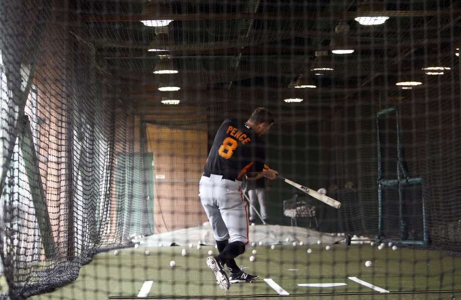 Hunter Pence, (8) takes a cut inside the cages during batting practice in Scottsdale, Arizona on Wednesday Feb. 19, 2014. The San Francisco Giants continue their spring training schedule in the Arizona desert with the full squad taking in practice at Scottsdale Stadium. Photo: The Chronicle