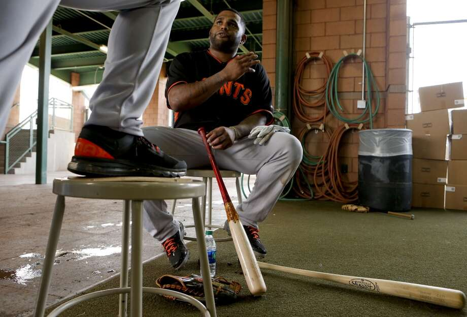 Pablo Sandoval, (48) talks with a coach near the batting cages as he takes a break during practice in Scottsdale, Arizona on Wednesday Feb. 19, 2014. The San Francisco Giants continue their spring training schedule in the Arizona desert with the full squad taking in practice at Scottsdale Stadium. Photo: The Chronicle