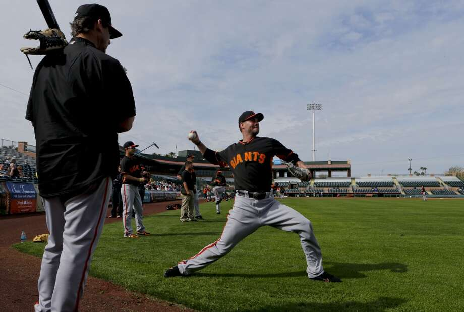 Giants' pitcher Ryan Vogelsong, (32) throws during practice in Scottsdale, Arizona on Wednesday Feb. 19, 2014. The San Francisco Giants continue their spring training schedule in the Arizona desert with the full squad taking in practice at Scottsdale Stadium. Photo: The Chronicle