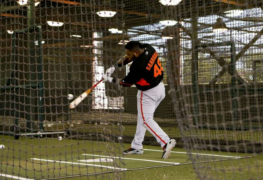 Pablo Sandoval, (48) connects inside the batting cages during practice in Scottsdale, Arizona on Wednesday Feb. 19, 2014. The San Francisco Giants continue their spring training schedule in the Arizona desert with the full squad taking in practice at Scottsdale Stadium. Photo: The Chronicle