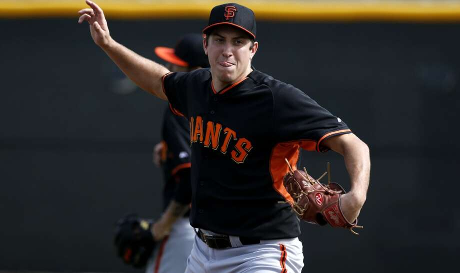 Derek Law, (64) goes through pitching drills during practice in Scottsdale, Arizona on Wednesday Feb. 19, 2014. The San Francisco Giants continue their spring training schedule in the Arizona desert with the full squad taking in practice at Scottsdale Stadium. Photo: The Chronicle