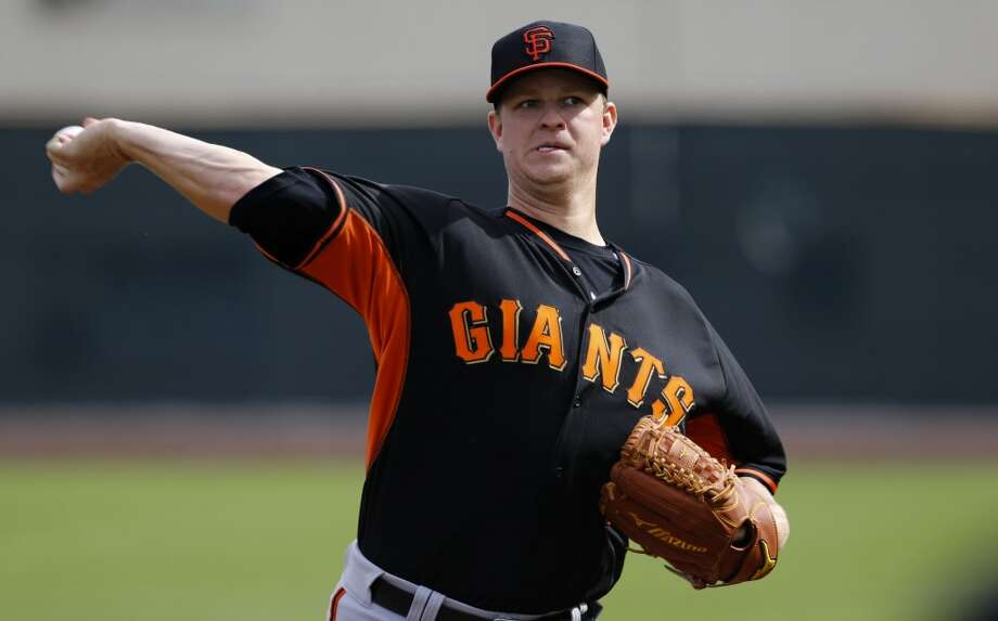 Giants' pitcher Matt Cain, (18) throws during pitcher drills in Scottsdale, Arizona on Wednesday Feb. 19, 2014. The San Francisco Giants continue their spring training schedule in the Arizona desert with the full squad taking in practice at Scottsdale Stadium. Photo: The Chronicle