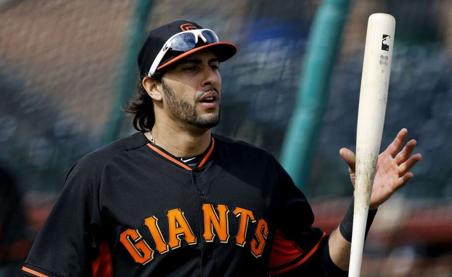 Giants' outfielder Michael Morse, (38) takes a break from batting practice in Scottsdale, Arizona on Wednesday Feb. 19, 2014. The San Francisco Giants continue their spring training schedule in the Arizona desert with the full squad taking in practice at Scottsdale Stadium. Photo: The Chronicle