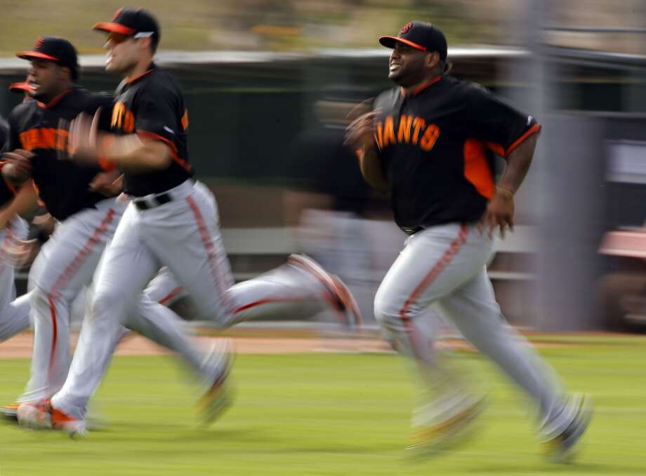 Giants' infielder Pablo Sandoval, (48) right, runs drills with his teammates in Scottsdale, Arizona on Wednesday Feb. 19, 2014. The San Francisco Giants continue their spring training schedule in the Arizona desert with the full squad taking in practice at Scottsdale Stadium. Photo: The Chronicle