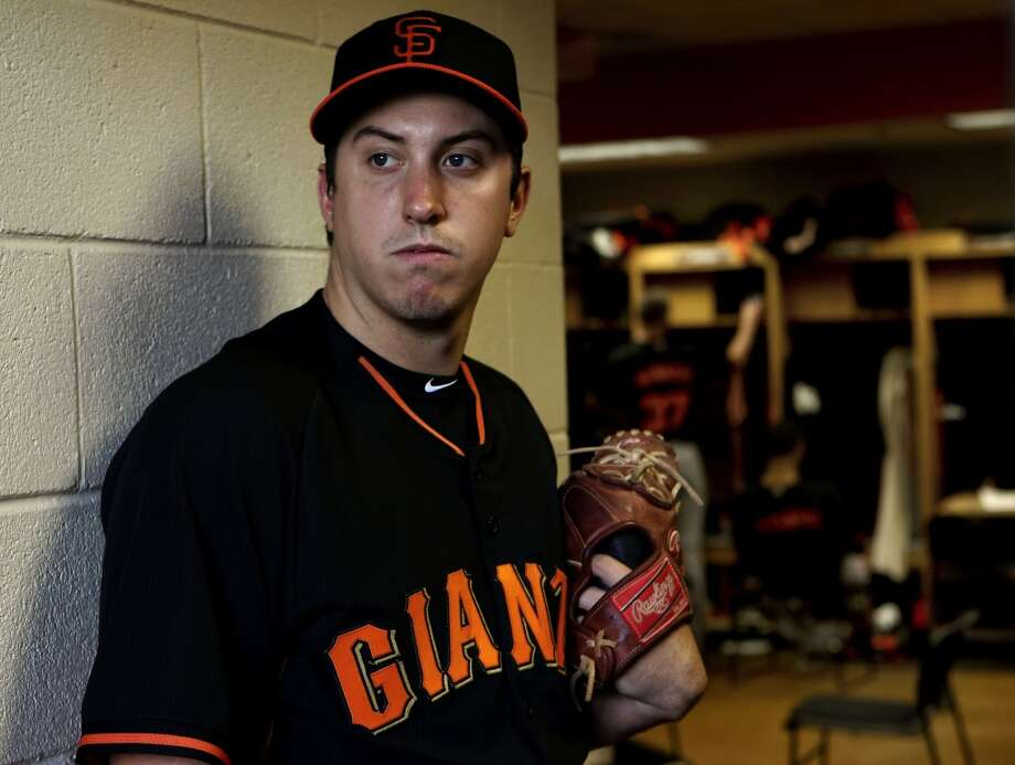 Giants' pitcher Derek Law, (64) in Scottsdale, Arizona on Wednesday Feb. 19, 2014. The San Francisco Giants continue their spring training schedule in the Arizona desert with the full squad taking in practice at Scottsdale Stadium. Photo: The Chronicle