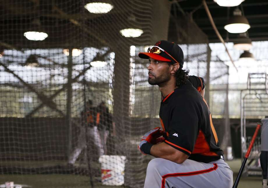 Angel Pagan, (16) waits his turn in the batting cages during practice in Scottsdale, Arizona on Wednesday Feb. 19, 2014. The San Francisco Giants continue their spring training schedule in the Arizona desert with the full squad taking in practice at Scottsdale Stadium. Photo: The Chronicle