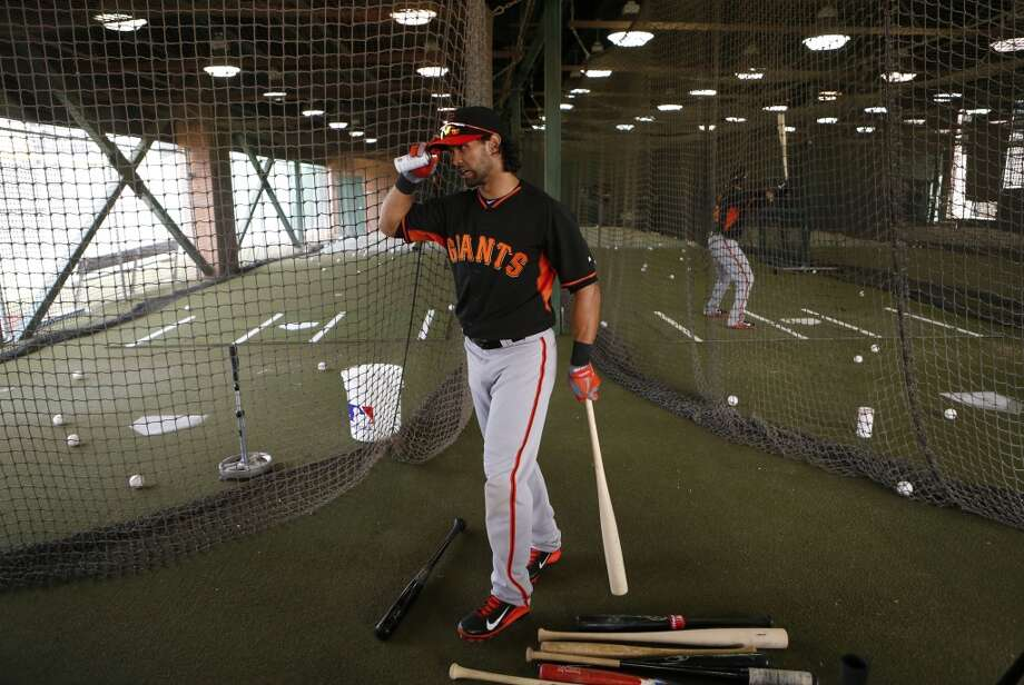 Angel Pagan, (16) heads to the batting cages during practice in Scottsdale, Arizona on Wednesday Feb. 19, 2014. TThe San Francisco Giants continue their spring training schedule in the Arizona desert with the full squad taking in practice at Scottsdale Stadium. Photo: The Chronicle