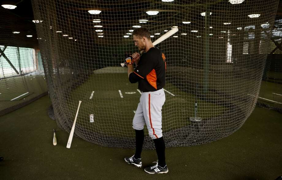 Hunter Pence, (8) heads for the cages during batting practice in Scottsdale, Arizona on Wednesday Feb. 19, 2014. The San Francisco Giants continue their spring training schedule in the Arizona desert with the full squad taking in practice at Scottsdale Stadium. Photo: The Chronicle
