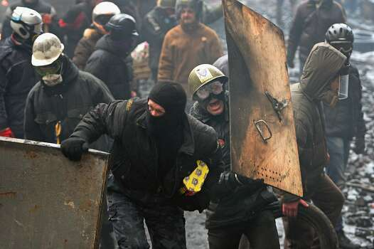 KIEV, UKRAINE - FEBRUARY 20:  Anti-government protesters continue to clash with police in Independence square, despite a truce agreed between the Ukrainian president and opposition leaders on February 20, 2014 in Kiev, Ukraine. After several weeks of calm, violence has again flared between police and anti-government protesters, who are calling to oust President Viktor Yanukovych over corruption and an abandoned trade agreement with the European Union.  (Photo by Jeff J Mitchell/Getty Images) Photo: Jeff J Mitchell, Getty Images