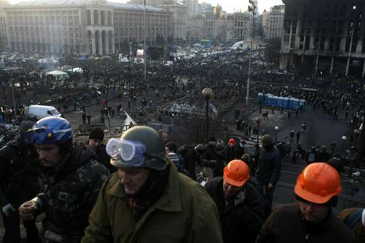 Anti-government protesters crowd the Independence Square in Kiev, Ukraine, Thursday, Feb. 20, 2014. Fearing that a call for a truce was a ruse, protesters tossed firebombs and advanced upon police lines Thursday in Ukraine's embattled capital. Government snipers shot back and the almost medieval melee that ensued left scores of people dead. (AP Photo/ Marko Drobnjakovic) Photo: Marko Drobnjakovic, Associated Press