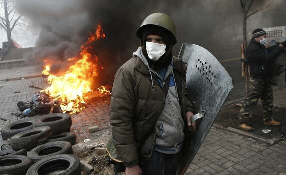 Anti-government protesters man a barricade in central Kiev, Ukraine, Thursday, Feb. 20, 2014. A brief truce in Ukraine's embattled capital failed Thursday, spiraling into fierce clashes between police and anti-government protesters. (AP Photo/Darko Bandic) Photo: Darko Bandic, Associated Press