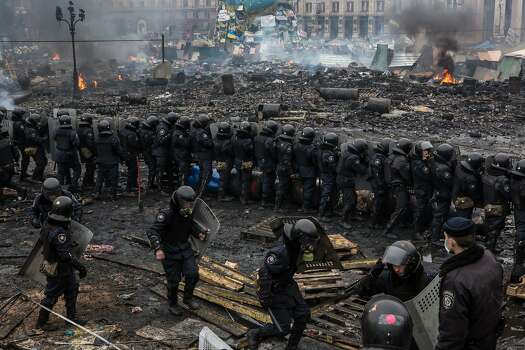 KIEV, UKRAINE - FEBRUARY 19: Police form a barrier in Independence Square on February 19, 2014 in Kiev, Ukraine. After several weeks of calm, violence has again flared between anti-government protesters and police as the Ukrainian parliament is meant to take up the question of whether to revert to the country's 2004 constitution. (Photo by Brendan Hoffman/Getty Images) Photo: Brendan Hoffman, Getty Images