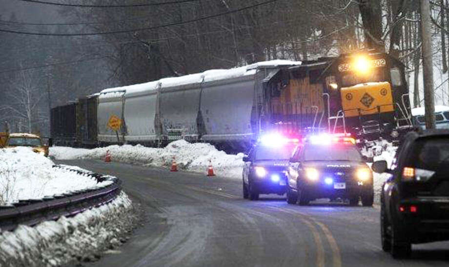 The front engine of a Housatonic Railroad freight train derailed Wednesday, Feb. 19, 2014, because of an ice buildup on the tracks  along Boardman Road in New Milford. Photo: Carol Kaliff / The News-Times
