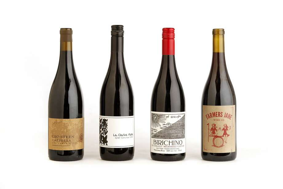 """Left-right: 2011 Leo Steen Calpella Red Table Wine, 2012 La Clarine Farm Syrah """"Sumu Kaw"""", 2012 Birichino Bechthold Vineyard Cinsault, 2012 Farmers Jane Wine Co. Field Red as seen in San Francisco, California on Wednesday, February 19, 2014. Photo: Craig Lee, Special To The Chronicle"""