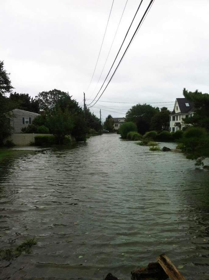 Flood waters cover Pebble Beach Lane in Westport's Saugatuck Shores section in the wake of Tropical Storm Irene. The state has reversed itself and said private homeowners in flood zones who want to elevate their homes can qualify for government assistance. Photo: Eric Sugerman / Westport News contributed