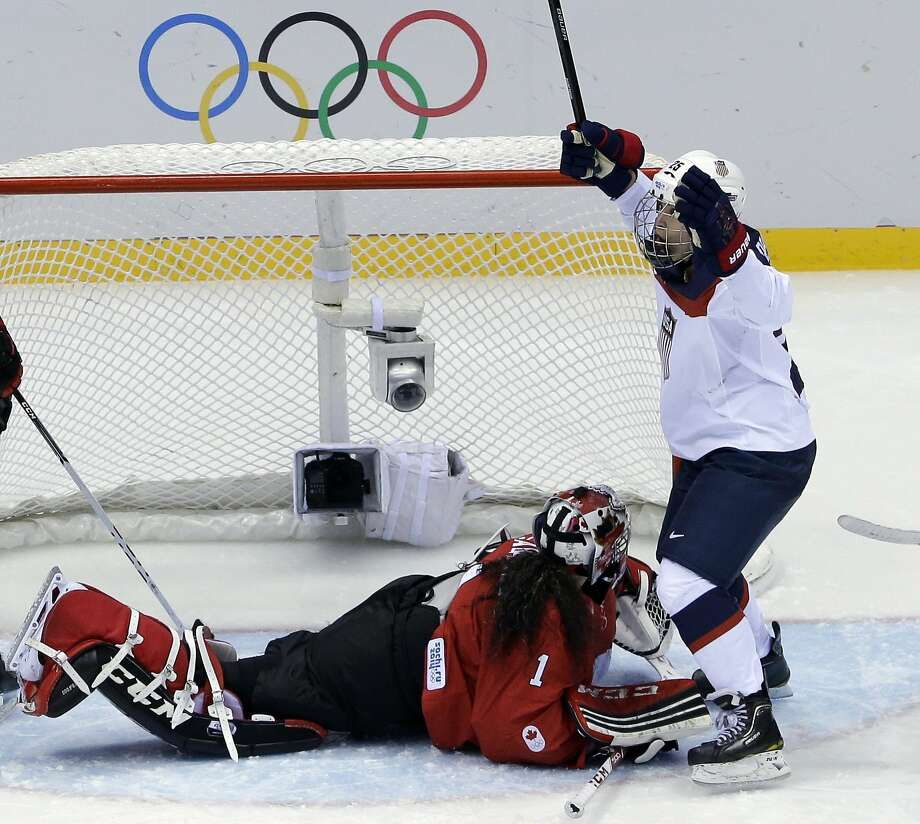 Alex Carpenter of the United States (25) reacts after scoring past goalkeeper Shannon Szabados of Canada (1) during the women's gold medal ice hockey game at the 2014 Winter Olympics, Thursday, Feb. 20, 2014, in Sochi, Russia. (AP Photo/David J. Phillip ) Photo: David J. Phillip, Associated Press