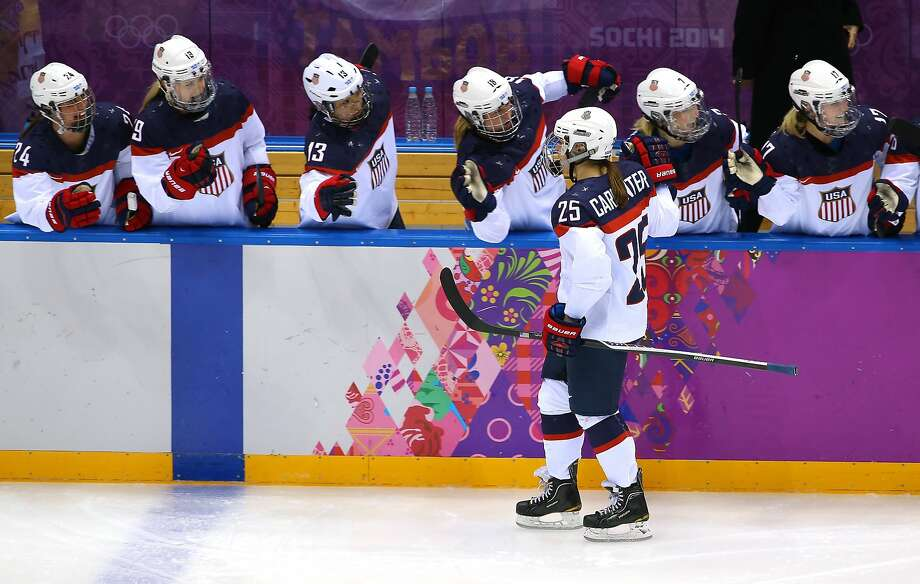 Alex Carpenter #25 of the United States celebrates scoring a third-period goal against Canada with teammates during the Ice Hockey Women's Gold Medal Game on day 13 of the Sochi 2014 Winter Olympics at Bolshoy Ice Dome on February 20, 2014 in Sochi, Russia. Photo: Doug Pensinger, Getty Images