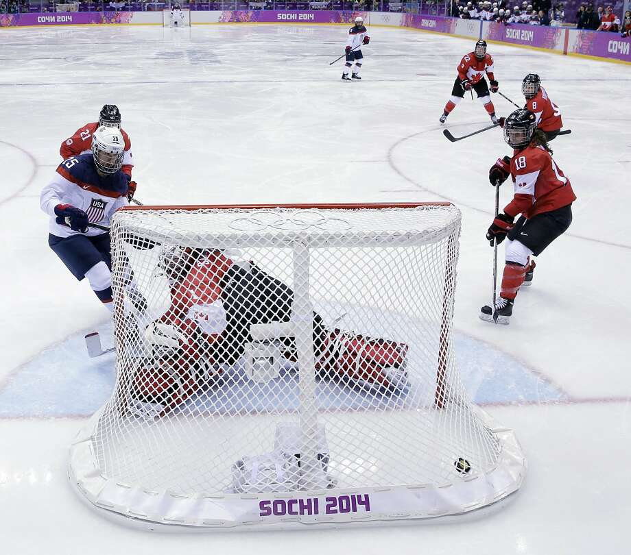 Alex Carpenter of the United States (25) scores past goalkeeper Shannon Szabados of Canada (1) during the women's gold medal ice hockey game at the 2014 Winter Olympics, Thursday, Feb. 20, 2014, in Sochi, Russia. (AP Photo/David J. Phillip ) Photo: David J. Phillip, Associated Press