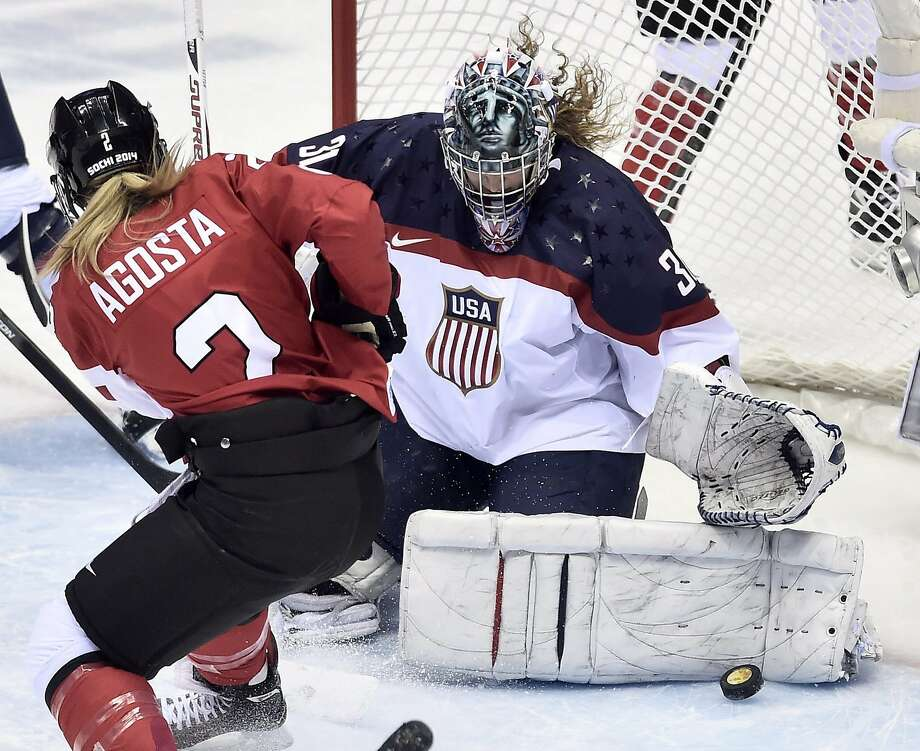 Meghan Agosta of Canada is stopped on a close-in scoring chance by goalie Jessie Vetter of the United States during the second period of the women's gold medal ice hockey game at the 2014 Winter Olympics, Thursday, Feb. 20, 2014, in Sochi, Russia. (AP Photo/The Canadian Press, Nathan Denette) Photo: Nathan Denette, Associated Press