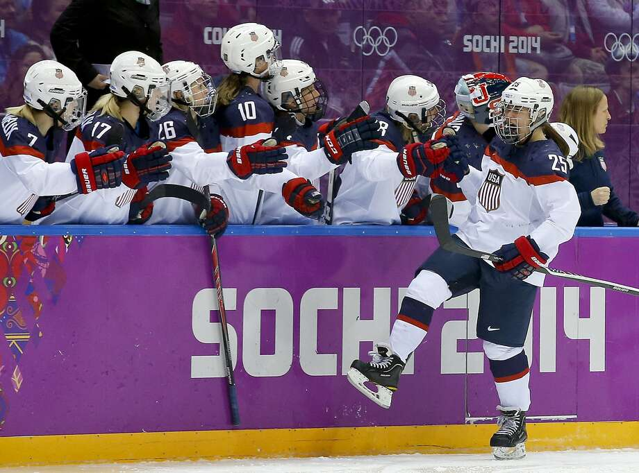 Alex Carpenter of the United States (25) celebrates with teammates after scoring a goal against Canada during the third period of the women's gold medal ice hockey game at the 2014 Winter Olympics, Thursday, Feb. 20, 2014, in Sochi, Russia. (AP Photo/Matt Slocum) Photo: Matt Slocum, Associated Press