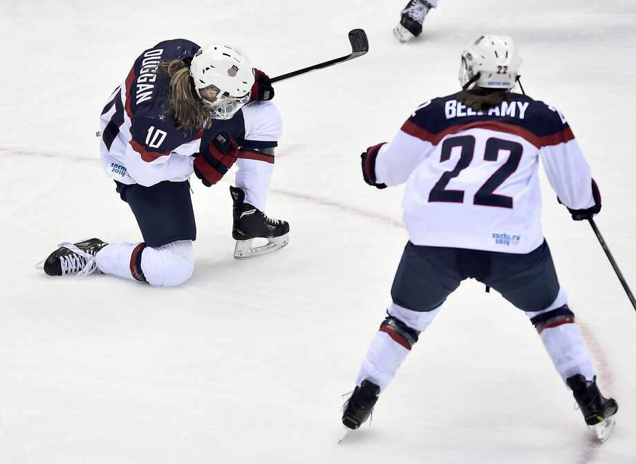 Meghan Duggan of the Untied States celebrates her goal against Canada with teammate Kacey Bellamy during the second period of the women's gold medal ice hockey game at the 2014 Winter Olympics, Thursday, Feb. 20, 2014, in Sochi, Russia. (AP Photo/The Canadian Press, Nathan Denette) Photo: Nathan Denette, Associated Press