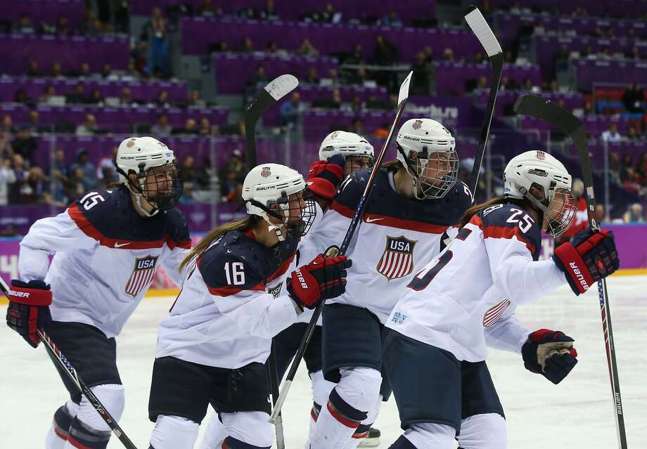 Alex Carpenter #25 of the United States celebrates scoring a third-period goal against Canada with teammates Hilary Knight #21, Kelli Stack #16 and Anne Schleper #15 during the Ice Hockey Women's Gold Medal Game on day 13 of the Sochi 2014 Winter Olympics at Bolshoy Ice Dome on February 20, 2014 in Sochi, Russia. Photo: Bruce Bennett, Getty Images