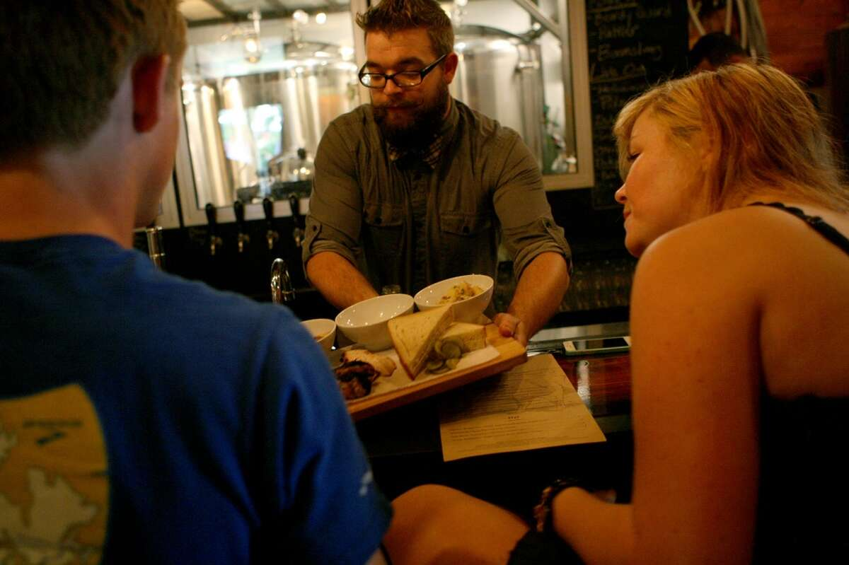 Alex Rattray serves the barbecue board at The Granary 'Cue & Brew. The Granary tied for Readers' Choice New Restaurant less than 1 year old. The restaurant, located at 602 Avenue A, opened in November of 2012.