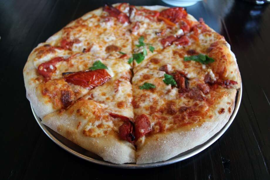 Among Barbaro's House Pizzas, this one has sweet peppers, smoked sausage and charred tomato. Photo: Jennifer McInnis, San Antonio Express-News