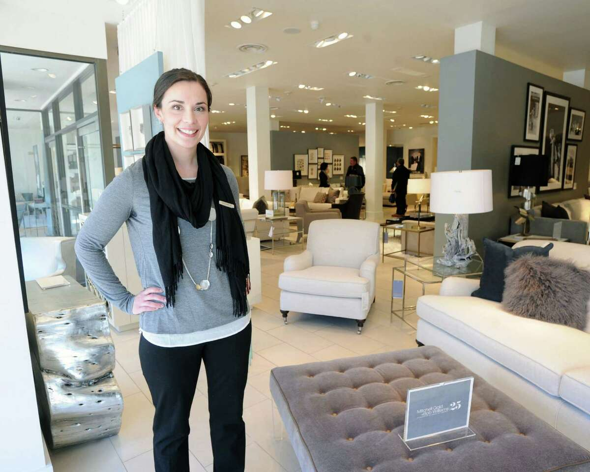 Michele Boniello of Mitchell Gold + Bob Williams, stands near a Kira Square Ottoman, lower right, in the Greenwich store, Thursday, Feb. 20, 2014. The home furnishings store is celebrating 25 years in business.