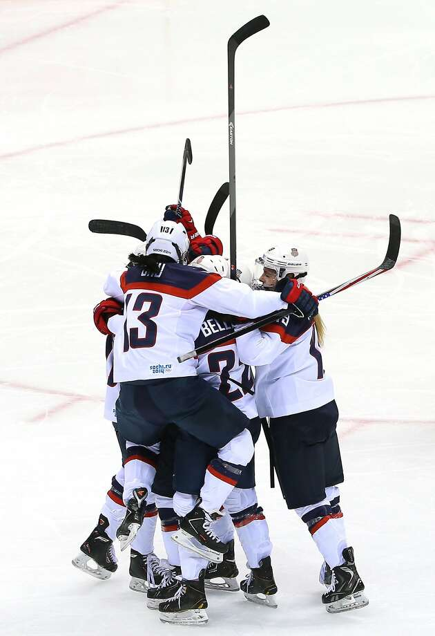 Meghan Duggan #10 of the United States celebrates with teammates Julie Chu #13, Kacey Bellamy #22, Jocelyne Lamoureux #17 and Gigi Marvin #19 after scoring a second-period goal during the Ice Hockey Women's Gold Medal Game on day 13 of the Sochi 2014 Winter Olympics at Bolshoy Ice Dome on February 20, 2014 in Sochi, Russia. Photo: Doug Pensinger, Getty Images