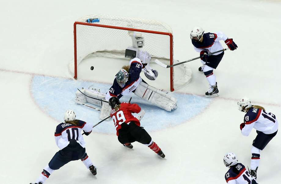 Marie-Philip Poulin #29 of Canada scores a third-period goal against Jessie Vetter #31 of the United States during the Ice Hockey Women's Gold Medal Game on day 13 of the Sochi 2014 Winter Olympics at Bolshoy Ice Dome on February 20, 2014 in Sochi, Russia.  Photo: Bruce Bennett, Getty Images
