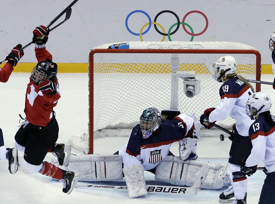 Marie-Philip Poulin of Canada (29) reacts after scoring past USA goalkeeper Jessie Vetter (31) of the women's gold medal ice hockey game at the 2014 Winter Olympics, Thursday, Feb. 20, 2014, in Sochi, Russia. (AP Photo/David J. Phillip ) Photo: David J. Phillip, Associated Press