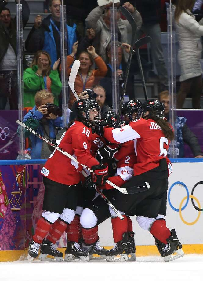 Marie-Philip Poulin #29 of Canada celebrates her third-period goal against the United States with teammates Catherine Ward #18, Meghan Agosta-Marciano #2 and Rebecca Johnston #6 during the Ice Hockey Women's Gold Medal Game on day 13 of the Sochi 2014 Winter Olympics at Bolshoy Ice Dome on February 20, 2014 in Sochi, Russia.  Photo: Bruce Bennett, Getty Images