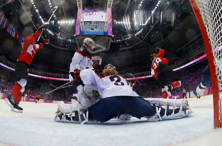 Marie-Philip Poulin #29 of Canada celebrates a third-period goal against Jessie Vetter #31 of the United States during the Ice Hockey Women's Gold Medal Game on day 13 of the Sochi 2014 Winter Olympics at Bolshoy Ice Dome on February 20, 2014 in Sochi, Russia. Photo: Pool, Getty Images