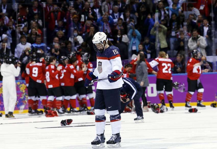 Anne Schleper of the United States (15) skates back to the bench after Canada scored in overtime to win the women's gold medal ice hockey game 3-2 at the 2014 Winter Olympics, Thursday, Feb. 20, 2014, in Sochi, Russia.