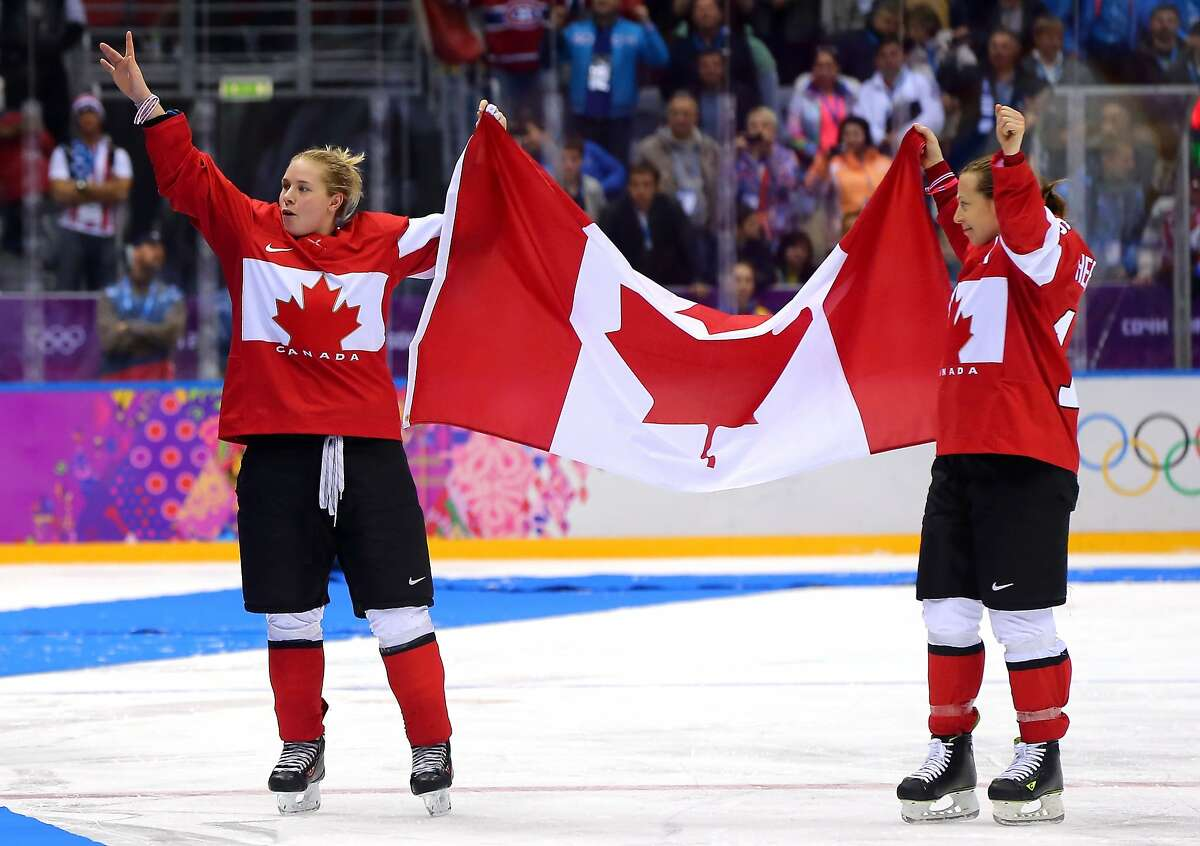Meghan Agosta-Marciano #2 and Jayna Hefford #16 of Canada celebrate after defeating the United States 3-2 in overtime during the Ice Hockey Women's Gold Medal Game on day 13 of the Sochi 2014 Winter Olympics at Bolshoy Ice Dome on February 20, 2014 in Sochi, Russia.