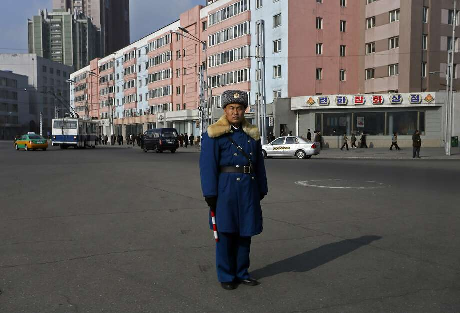 Wish there were some cars to signal:A traffic cop in Pyongyang is like the Maytag 