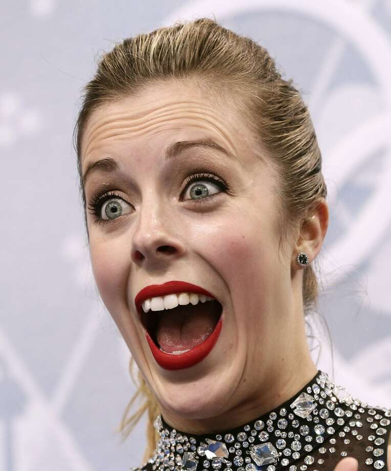 But how do you really feel, Ashley? U.S. figure skater Ashley Wagner reacts with her usual stony-faced expression after receiving a 65.21 from the judges in the short program at Sochi. The score put her in sixth place at the time. Photo: Bernat Armangue, Associated Press