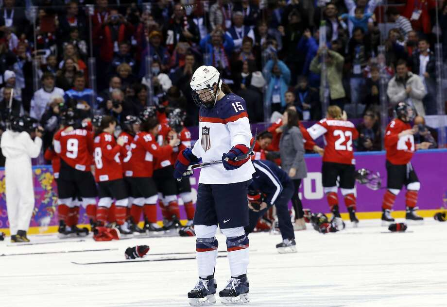 Anne Schleper of the United States (15) skates back to the bench after Canada scored in overtime to win the women's gold medal ice hockey game 3-2 at the 2014 Winter Olympics, Thursday, Feb. 20, 2014, in Sochi, Russia.  Photo: Matt Slocum, Associated Press