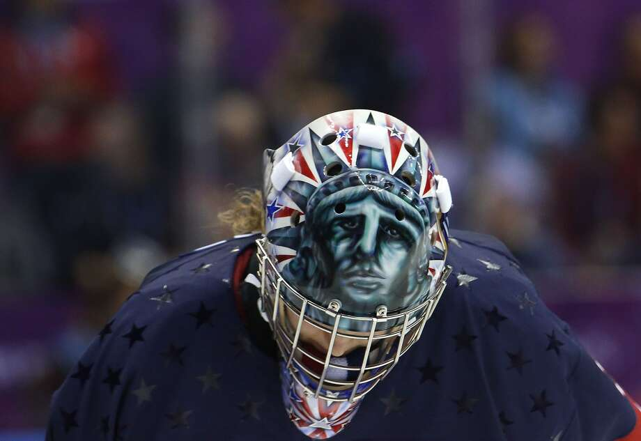 USA goalkeeper Jessie Vetter (31) looks down during a break in play during overtime of the women's gold medal ice hockey game against Canada at the 2014 Winter Olympics, Thursday, Feb. 20, 2014, in Sochi, Russia. (AP Photo/Mark Humphrey) Photo: Mark Humphrey, Associated Press