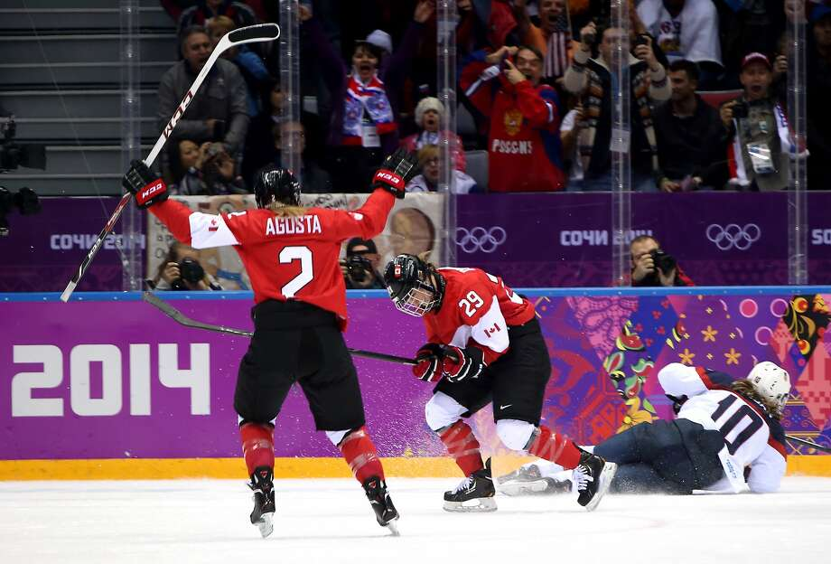 Marie-Philip Poulin #29 of Canada celebrates her goal with Meghan Agosta-Marciano #2 in the third period against the United States during the Ice Hockey Women's Gold Medal Game on day 13 of the Sochi 2014 Winter Olympics at Bolshoy Ice Dome on February 20, 2014 in Sochi, Russia. Photo: Bruce Bennett, Getty Images