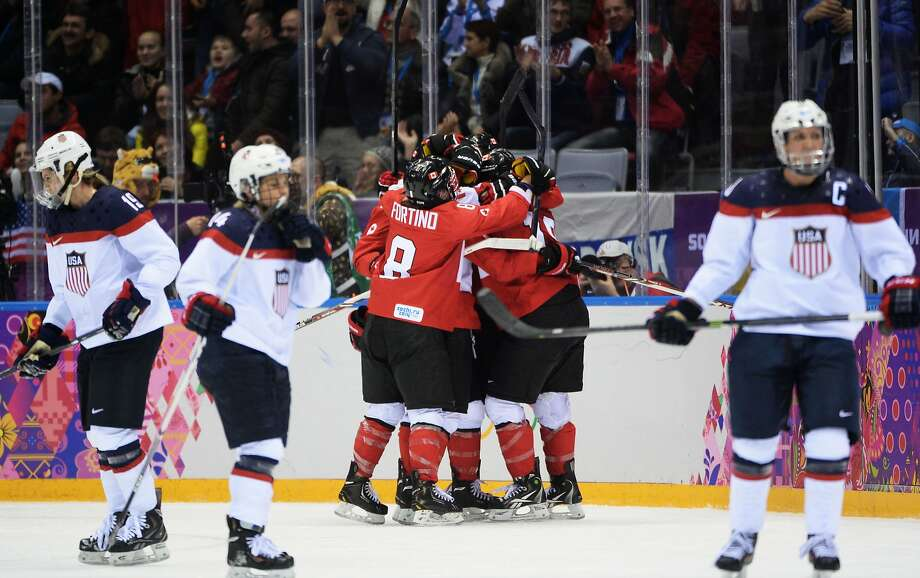 Brianne Jenner #19 of Canada celebrates her goal against the United States in the third period during the Ice Hockey Women's Gold Medal Game on day 13 of the Sochi 2014 Winter Olympics at Bolshoy Ice Dome on February 20, 2014 in Sochi, Russia. Photo: Harry How, Getty Images