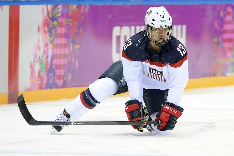 Julie Chu #13 of the United States kneels on the ice during the Ice Hockey Women's Gold Medal Game against Canada on day 13 of the Sochi 2014 Winter Olympics at Bolshoy Ice Dome on February 20, 2014 in Sochi, Russia.  Photo: Harry How, Getty Images