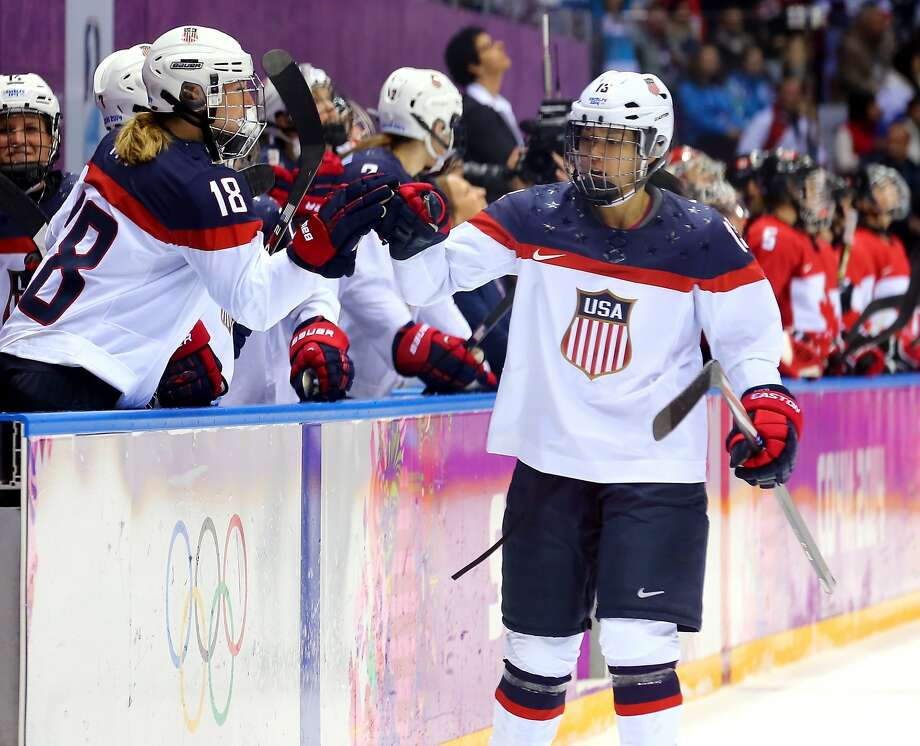 Julie Chu #13 of the United States celebrates with teammates after Meghan Duggan #10 scored a second-period goal against Canada during the Ice Hockey Women's Gold Medal Game on day 13 of the Sochi 2014 Winter Olympics at Bolshoy Ice Dome on February 20, 2014 in Sochi, Russia. Photo: Martin Rose, Getty Images