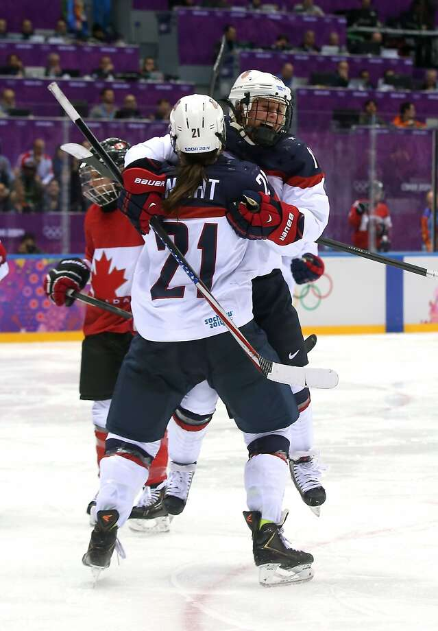 Hilary Knight #21 and Kelli Stack #16 of the United States celebrate after teammate Alex Carpenter #25 scored a third-period goal against Canada during the Ice Hockey Women's Gold Medal Game on day 13 of the Sochi 2014 Winter Olympics at Bolshoy Ice Dome on February 20, 2014 in Sochi, Russia.  Photo: Bruce Bennett, Getty Images