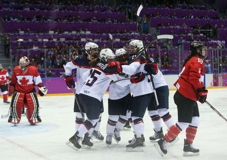 Alex Carpenter #25 of the United States celebrates scoring a third-period goal against Shannon Szabados #1 of Canada with teammates during the Ice Hockey Women's Gold Medal Game on day 13 of the Sochi 2014 Winter Olympics at Bolshoy Ice Dome on February 20, 2014 in Sochi, Russia.  Photo: Bruce Bennett, Getty Images